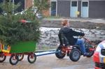 Kinderen gaan op kerstbomenjacht